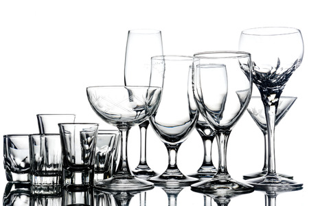 Collage of empty glasses on white background. Фото со стока