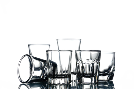Collage of empty glasses on white background. Stock Photo