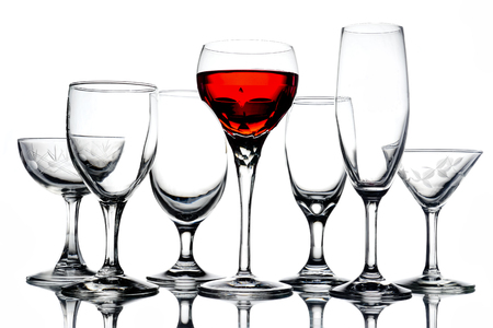 Collage of empty glasses with wine on white background. Stock Photo