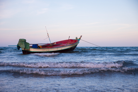 Traditional fishing boat in the sea. Stock Photo