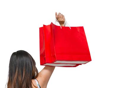 흰색 배경에 쇼핑 가방을 들고 여성 손 닫습니다.