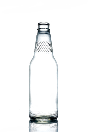 Empty colorless glass bottle on a white background.
