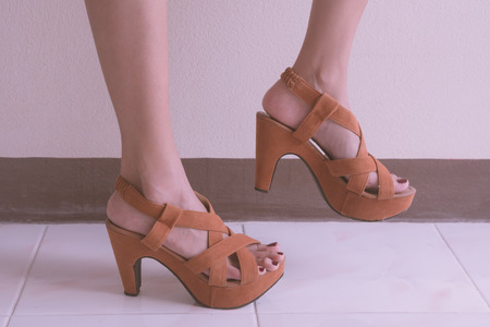 close up: Close up of female lags with high heels shoes.