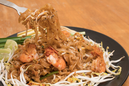 Close up plate of Padthai, Thai noodle with fried shrimp and vegetable,Thai Food, Thailands national dishes. Stock Photo