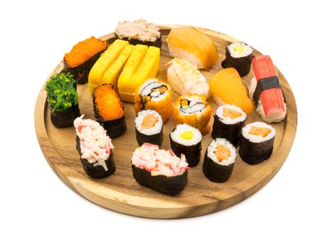 Sushi set on wooden plate on white background, Japanese food.