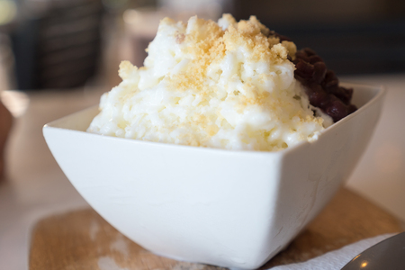 Shaved ice with red bean and milk. Stock Photo