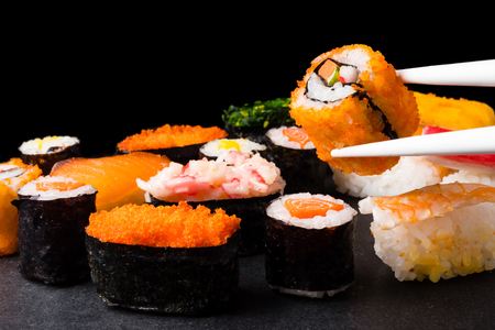 Sushi set on black background, Japanese food. Imagens