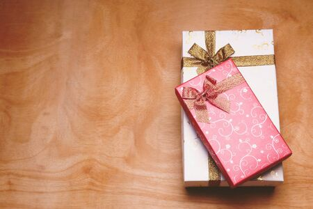 Top view of gift boxes on the wooden table. Free space for text Stock Photo