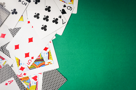Playing cards on green background. Free space for text Stock fotó