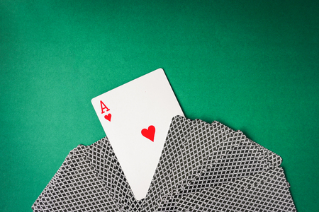 Heart ace with playing cards on green background. Free space for text Reklamní fotografie - 84883068