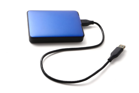 External hard disk drive with cable on a white background.