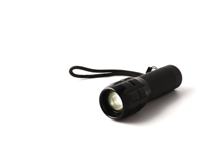 black metallic background: LED Flashlight on a white background, Free space for text. Stock Photo