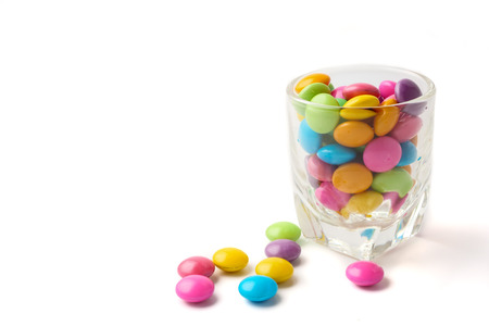 Colorful candies in glass on white background, Free space for text.