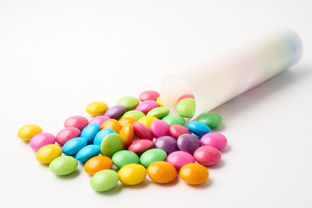 Colorful candies on a white background. Stock fotó