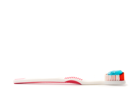 Toothbrush with toothpaste on a white background. Free space for text Stock Photo