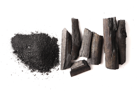 Charcoal and powder (activated carbon) on white background. Stock Photo - 85843807