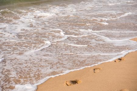 Footprints on a sandy beach. Travel concept Stock Photo