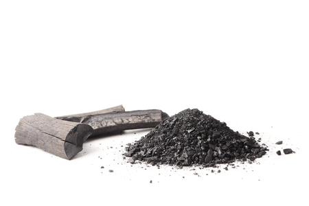 Charcoal and powder (activated carbon) on white background.