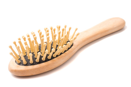 Wooden comb on a white background. Stock fotó