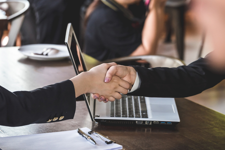 Successful business people shaking hands, finishing up a meeting. Reklamní fotografie