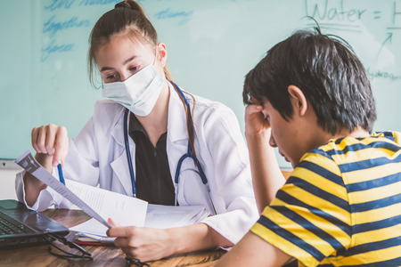 Female doctor explaining diagnosis to her patient. Young pretty future doctor on classes learning how to treat a patient Stock Photo