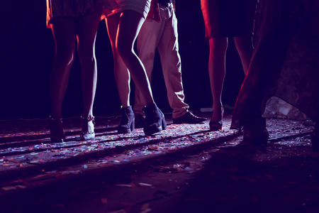 Legs of dancing people at the party. 版權商用圖片