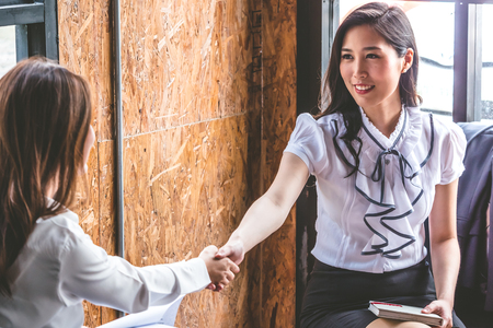 Successful business people shaking hands, finishing up a meeting. Stock Photo