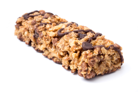 Chocolate cereal bars with wheat whole grain and chocolate on a white background.