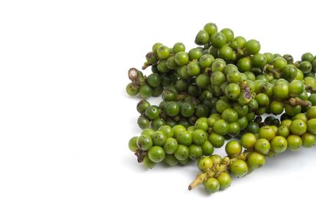Green peppercorns on white background. Stock Photo