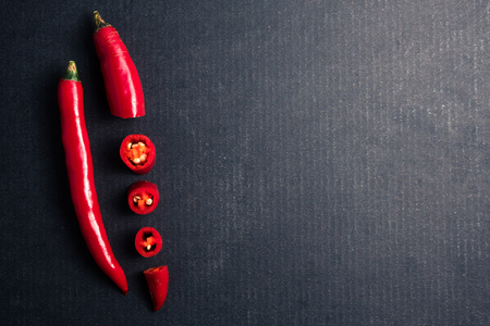 Fresh Red chili papper on black background. Free space for text
