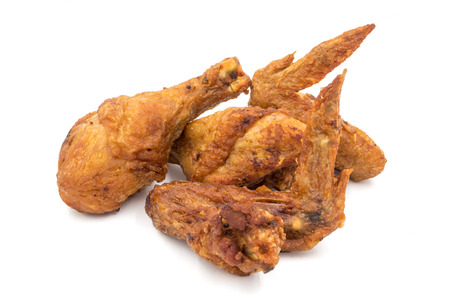 Fried chicken legs and wings on a white background.
