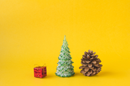 Christmas decorations on yellow background. Imagens