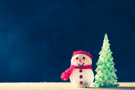 Christmas decorations on the wooden table, black background, free space for text, vintage tone Stock Photo
