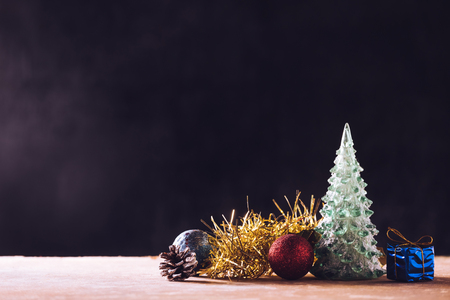 Christmas decorations on the wooden table, black background, free space for text