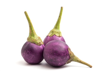 Fresh Purple eggplants on white background.