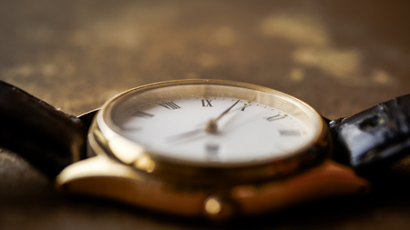 Close up front view of a modern wrist watch on the table. Soft focus Stock fotó