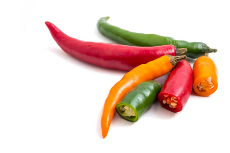 Colorful mix of chili pappers on white background. Stock Photo