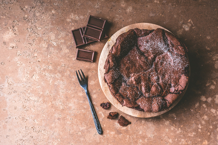 Top view of Chocolate cake on wooden tray with fork. Stock Photo