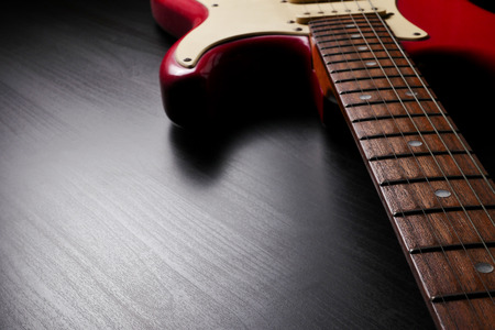 Close up of Electric guitar body and neck detail on black background. Foto de archivo