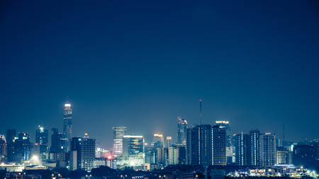 View of the business area in Bangkok at night, Bangkok is the capital of Thailand and is a popular tourist destination. Stock Photo