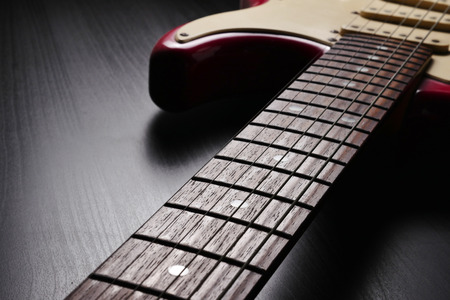 Close up of Electric guitar body and neck detail on black background. Stock Photo