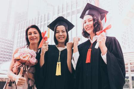 Beautiful woman congratulates for her family on graduation day, Successful concept Banco de Imagens