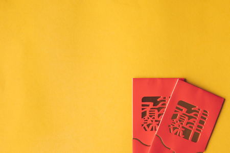 Top view of Red packets (Ang Pao) on yellow background. Chinese new year concept. Free space for text