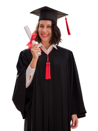 Portrait of Young woman with graduation cap and gown holding diploma isolated on white background, Successful concept Stock Photo