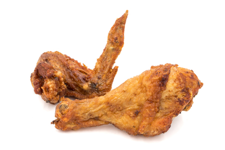Fried chicken leg and wing on a white background.