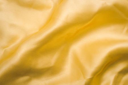 Golden fabric texture background Stockfoto