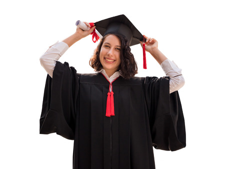 Portrait of Young woman with graduation cap and gown holding diploma isolated on white background, Successful concept 스톡 콘텐츠
