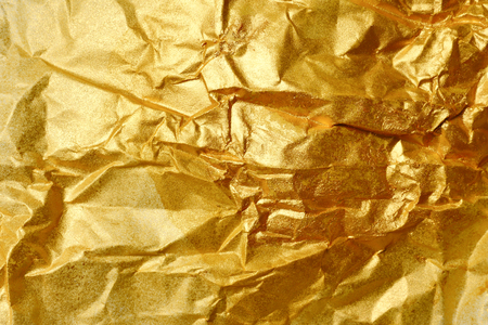 Abstract texture background of wrinkled golden paper