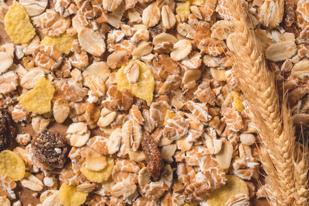 Oatmeal flakes as background. Healthy breakfast concept.