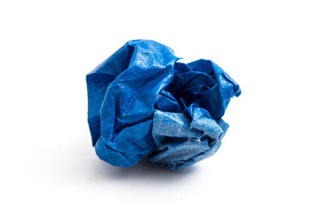 Blue crumpled paper ball on a white background 写真素材